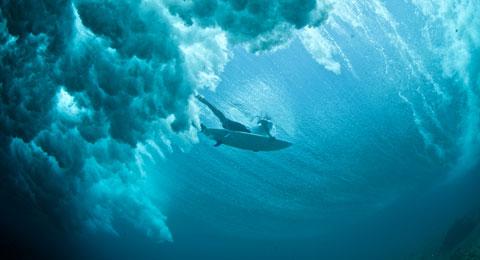 Surfer duck diving