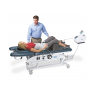 Triton DTS® Traction Unit with table and patient in supine position